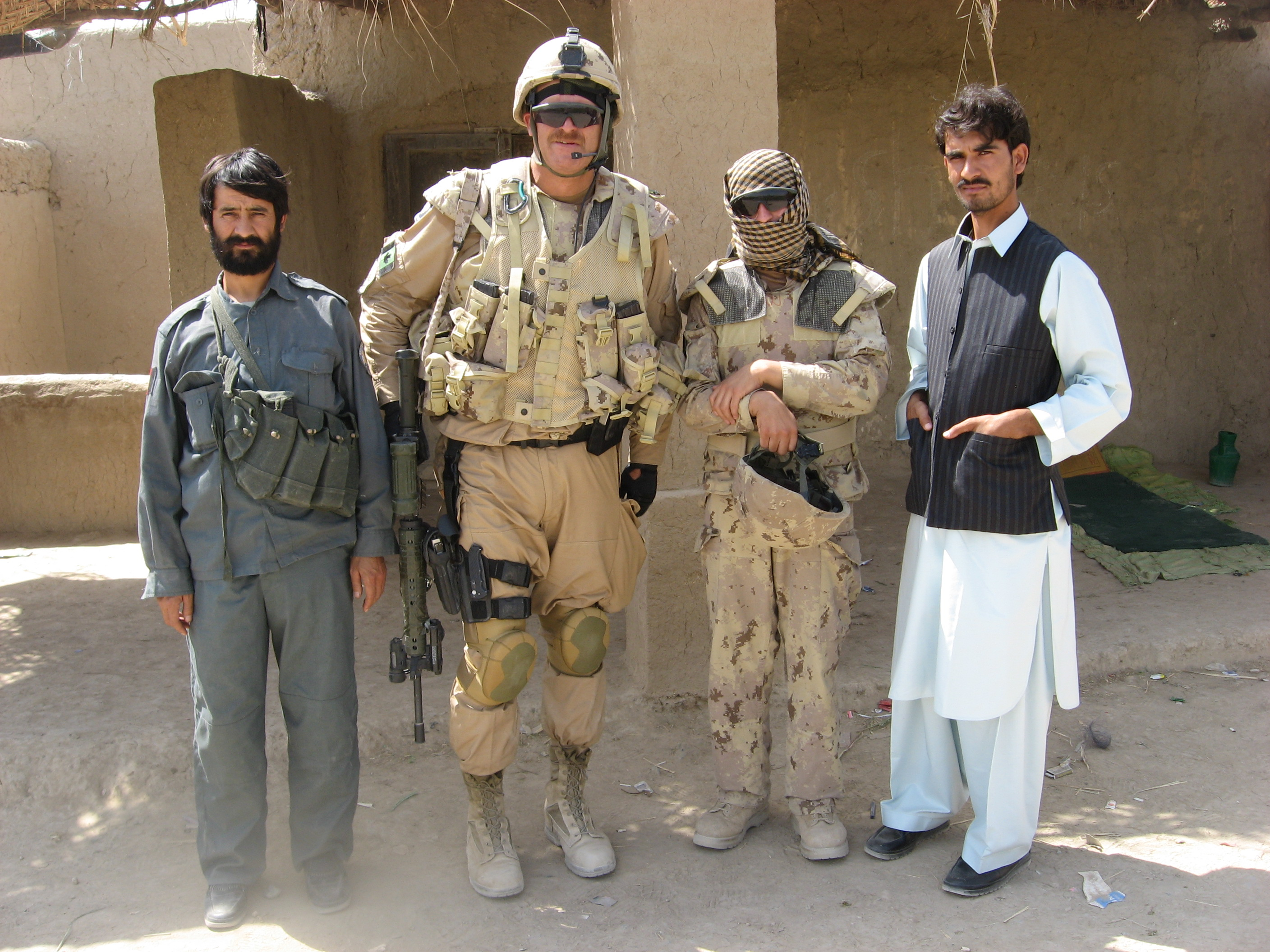 Sgt. Coakeley with local ANP authorities at the scene of an IED find, Kandahar City